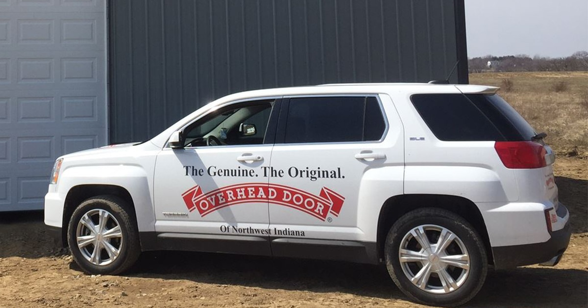 Overhead Door Company of Northwest Indiana thanks Quint's Signs Overnite for their vehicle wraps